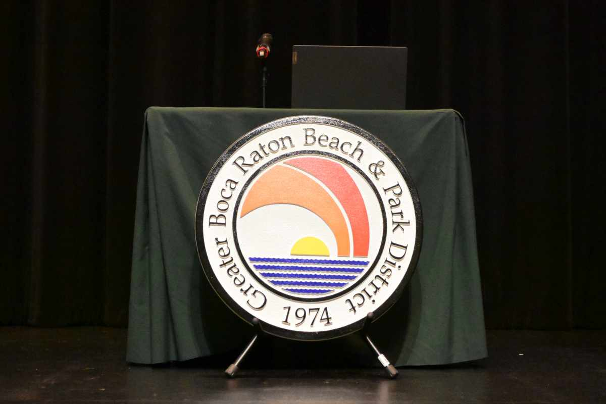 District seal in front of new desk
